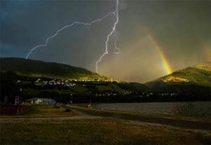 Landscape scene of lightning and rainbow