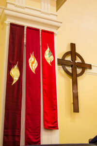 Banners inside St Andrew's next to the presbyterian cross
