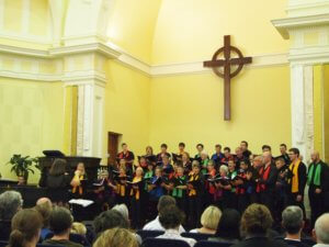 Choir singing on the stage at St Andrew's