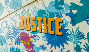'Justice' part of the St Andrew's mural outside the church