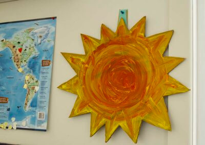 childrens artwork in the Rainbow Room, sun painting